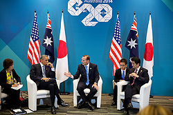 President Barack Obama participates in a trilateral meeting with Prime Minister Tony Abbott of Australia and Prime Minister Shinzo Abe of Japan, right, at the Brisbane Convention and Exhibition Center, Brisbane, Queensland, Australia, Nov. 16, 2014. (Official White House Photo by Pete Souza)<br /> <br /> This official White House photograph is being made available only for publication by news organizations and/or for personal use printing by the subject(s) of the photograph. The photograph may not be manipulated in any way and may not be used in commercial or political materials, advertisements, emails, products, promotions that in any way suggests approval or endorsement of the President, the First Family, or the White House.