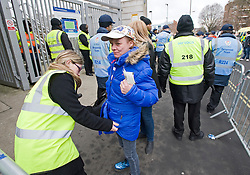 © Ben Cawthra. 28/01/2012. A female Chelsea supporter is searched by security before the Barclays Premiership football match between QPR and Chelsea. Security has been heightened due to tensions between the clubs following an on field alleged racial incident. Photo credit : Ben Cawthra