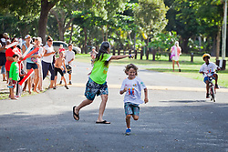 "Aelan Elder races for the finish line as a part of a relay team in the 5-8 age category.  ""Run, Bike, Swim"" the Rotary Sunrise Kids Triathalon at Magens Bay.  St. Thomas, USVI.  11 April 2015.  © Aisha-Zakiya Boyd"