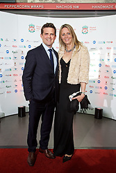 LIVERPOOL, ENGLAND - Tuesday, May 19, 2015: Liverpool's xxxx arrives on the red carpet with his wife for the Liverpool FC Players' Awards Dinner 2015 at the Liverpool Arena. (Pic by David Rawcliffe/Propaganda)