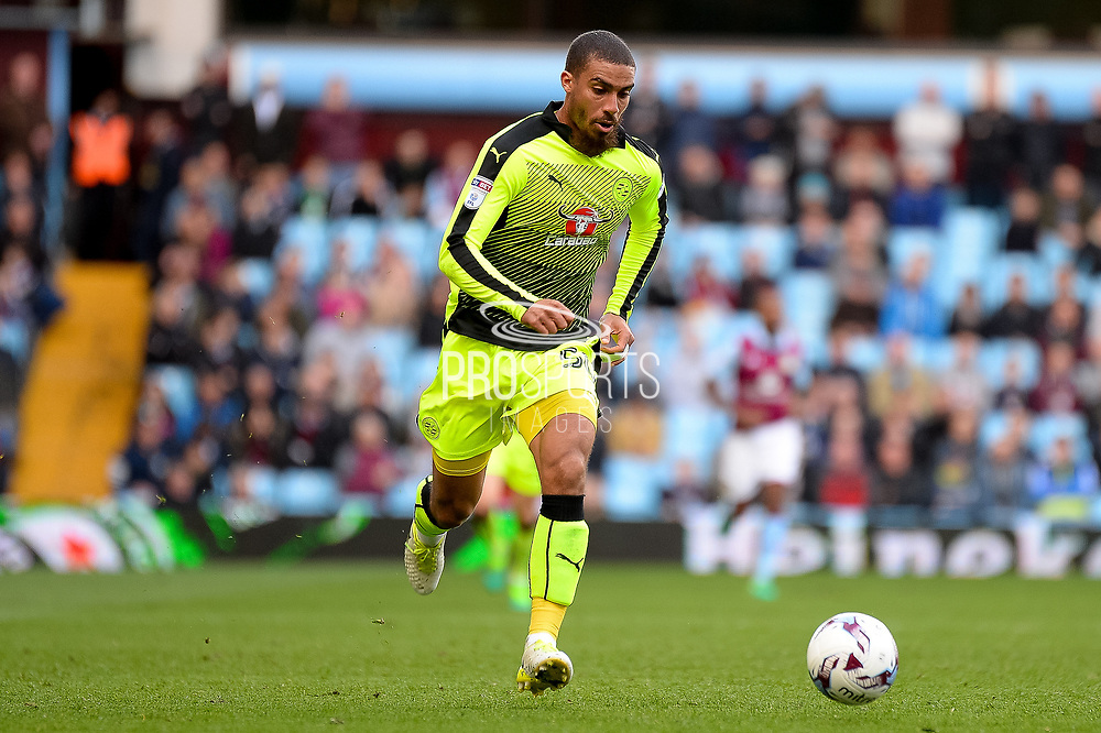 Reading striker (on loan from Bournemouth) Lewis Grabban (50) sprints forward with the ball during the EFL Sky Bet Championship match between Aston Villa and Reading at Villa Park, Birmingham, England on 15 April 2017. Photo by Dennis Goodwin.