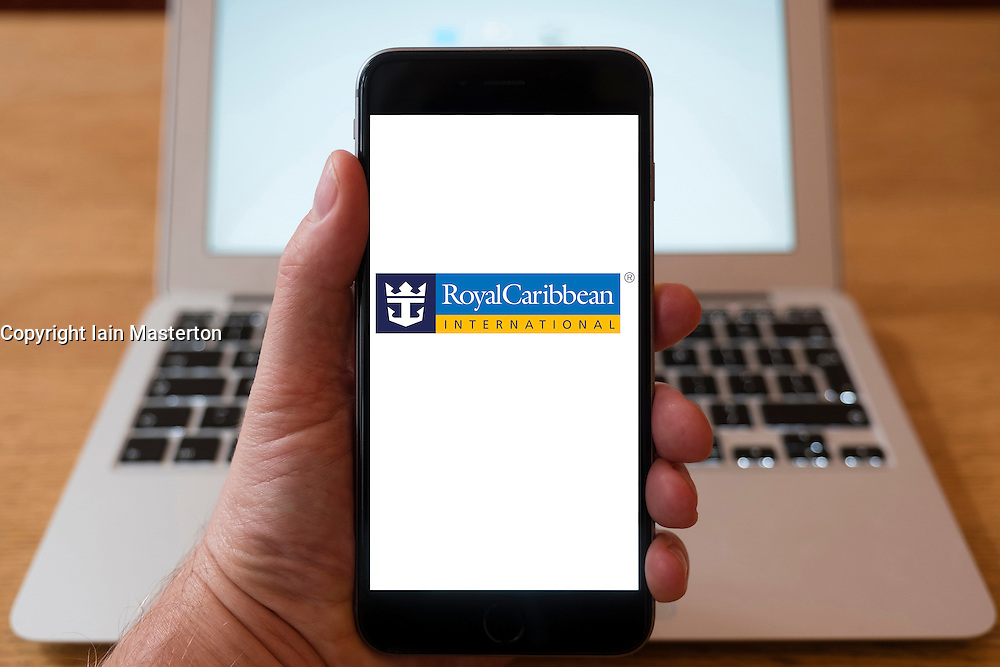 Using iPhone smartphone to display logo of Royal Caribbean cruise company