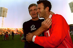 MINSK, BELARUS - Saturday, September 4, 1999: Wales's manager Mark Hughes and match-winner Ryan Giggs celebrate beating Belarus during the UEFA Euro 2000 Qualifying Group One match at the Dinamo Stadium. (Mandatory credit: David Rawcliffe/Propaganda)