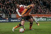Harry Maguire (Hull City) and Theo Walcott (Arsenal) during the The FA Cup fifth round match between Hull City and Arsenal at the KC Stadium, Kingston upon Hull, England on 8 March 2016. Photo by Mark P Doherty.