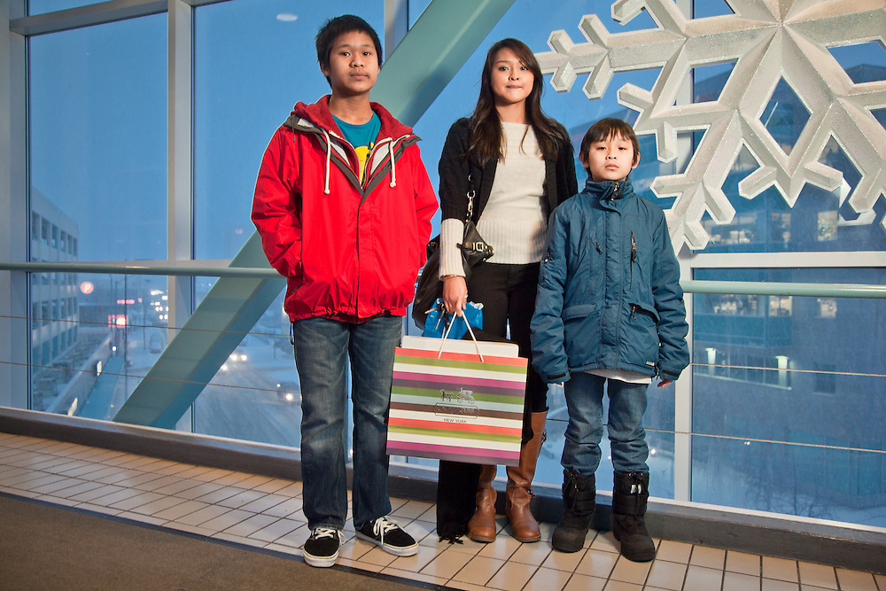 Christmas shoppers, Joseph, age 14, Kristi, age 17, and Austin, age 9, on the overpass at the Fifth Avenue Mall, Anchorage.