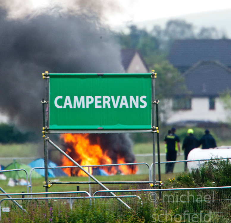 A fire breaks out at the campervans site..T in the Park on Monday 11th July 2011. T in the Park 2011 music festival takes place from 7-10th July 2011 in Balado, Fife, Scotland..©Pic : Michael Schofield.