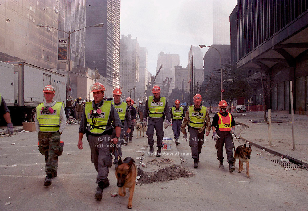 "Trooper dogs(dead dogs) evacuated lower manhattan on sunday because another part of a building collapsed. The dogs are used nto locate bodies in the rubble fron the Sept. 11th attack at the world trad centery in lower Manhattan Sunday 16,2001.(Photo/Suzi Altman) Through my eyes and with my camera I am able to see the world we live in, and try to bring things into focus. Photography preserves my vision of what ""I see"" at a specific time and place- a moment. Creating a bond between  me and my subject and capturing and emotion for eternity. Having lived and worked in New York City for over 15 years when 911 happened. I had to go and ""see"" with my camera what lower Manhattan was like after this horrific attack on our Nation. The World Trade Center owned the skyline in lower Manhattan making it feel more like a canyon. After the Twin Towers fell, and I saw with my own eyes and camera the destruction, I realized what little land they actually sat on. The Twin Towers may not have occupied a large plot of land but they now touched everyones life. Photo©SuziAltman"