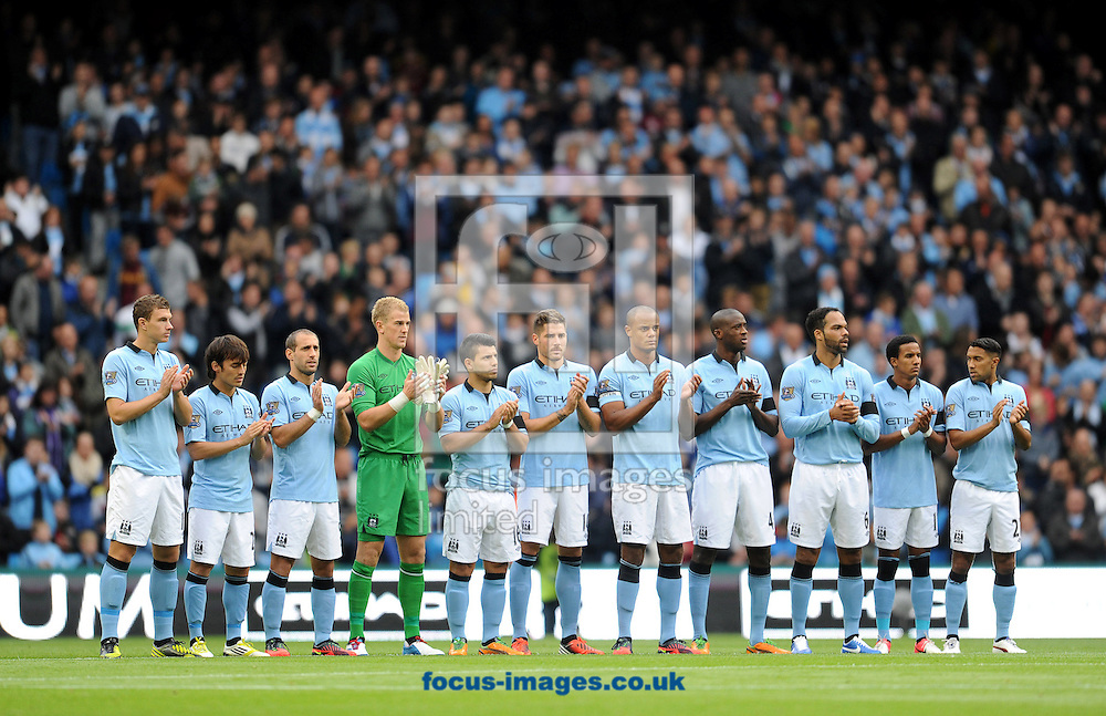 Picture by Andrew Timms/Focus Images Ltd +44 7917 236526.23/09/2012.Manchester City players pay their respects to murdered PC's Fiona Bone and Nicola Hughes prior to the Barclays Premier League match against Arsenal at the Etihad Stadium, Manchester.
