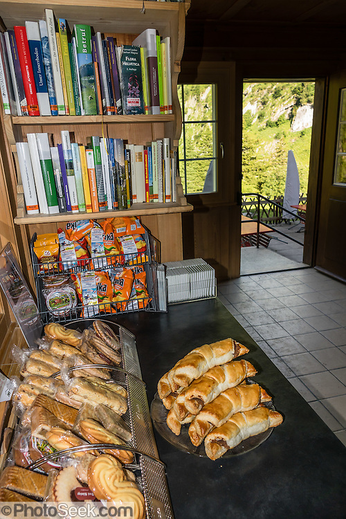 Pastries for sale. Berggasthaus Bollenwees was founded in 1903 at scenic Fälensee lake in the Alpstein range, Appenzell Alps, Switzerland, Europe. Bollenwees is a wonderful place to stay overnight in private double ensuite or dormitory rooms. A spectacular ridge walk covered in wildflower gardens starts at Hoher Kasten, reached via cable car from Brülisau, just 10 minutes bus ride from Appenzell village. For a wonderful day hike, take the lift; or arranging for overnight stay at Berggasthaus Staubern or beautiful Bollenwees allows time to ascend Hoher Kasten summit (1794 m) on foot. Appenzell Innerrhoden is Switzerland's most traditional and smallest-population canton (second smallest by area).