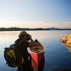 A photographer on Seboeis Lake near Millinocket, Maine.