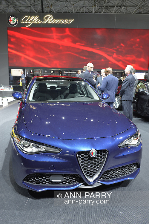 A blue metallic 2017 Alfa Romeo Giula is on display at the New York International Auto Show 2016, at the Jacob Javits Center. This was Press Preview Day one of NYIAS, and the Trade Show will be open to the public for ten days, March 25th through April 3rd.