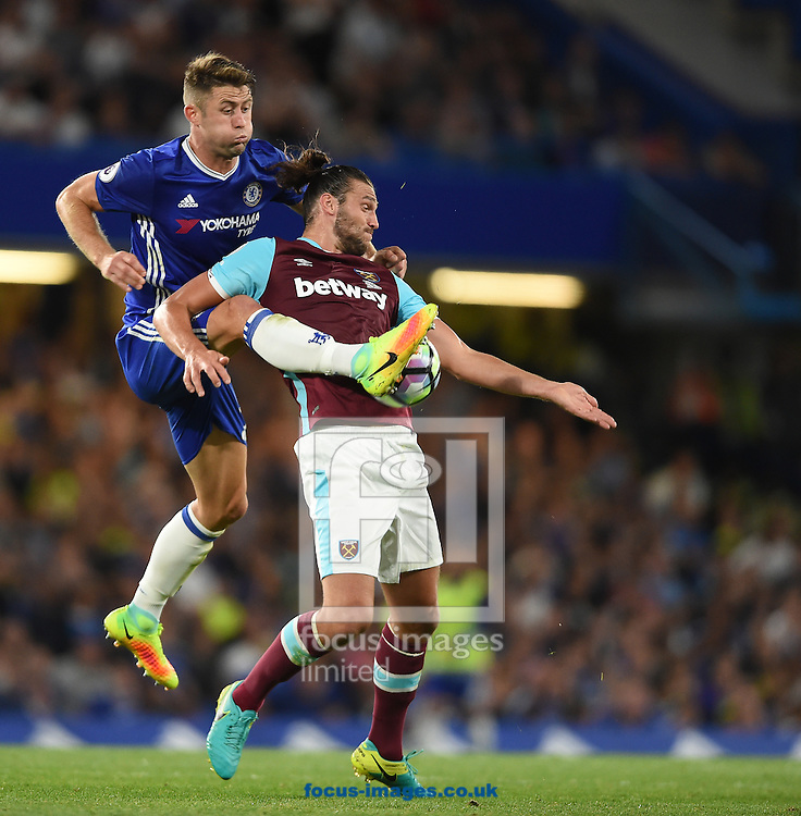 Gary Cahill of Chelsea and Andy Carroll of West Ham United during the Premier League match at Stamford Bridge, London<br /> Picture by Daniel Hambury/Focus Images Ltd +44 7813 022858<br /> 15/08/2016