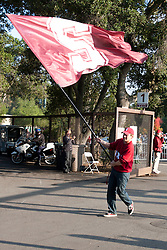 Nov 12, 2011; Stanford CA, USA;  A Stanford Cardinal supporter waves a flag before the game against the Oregon Ducks at Stanford Stadium.  Oregon defeated Stanford 53-30. Mandatory Credit: Jason O. Watson-US PRESSWIRE