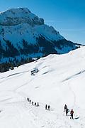 Gef&uuml;hrte Schneeschuhwanderung im Eigenthal am Fuss des Pilatus in Kanton Luzern Schweiz<br /> <br /> A group of people with snowshoes hiking in Switzerland