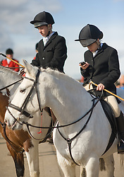 © Licensed to London News Pictures. 10/03/2012..Cleveland, England..A rider does a final check for messages on her phone at the start of the Cleveland Hunt on Teesside. ..Photo credit : Ian Forsyth/LNP