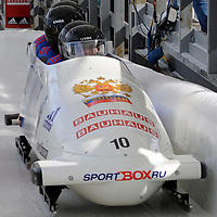 01 March 2009:     The Russia 2 bobsled driven by Dmitry Abramovitch with sidepushers Philipp Egorov and Alexey Seliverstov, and brakeman Petr Moiseev finish their 5th place run at the 4-Man World Championships competition on March 1 at the Olympic Sports Complex in Lake Placid, NY.  The USA 1 bobsled driven by Steven Holcomb with sidepushers Justin Olsen and Steve Mesler, and brakeman Curtis Tomasevicz won the competition and the World Championship bringing the U.S. their first world championship since 1959 with a time of 3:36.61.