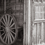 Wagon wheel and garage in Bodie State Park.