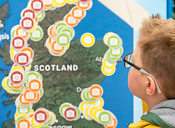 Dynamic Earth, Edinburgh, Scotland, United Kingdom, 9 April 2019. Edinburgh Science Festival:  Jamie Carter, age 8 years, has fun learning about plastic pollution in the sea at Scrapbook: Fight Ocean Plastics from the Skies at Dynamic Earth at the Edinburgh Science Festival. <br /> <br /> Sally Anderson | EdinburghElitemedia.co.uk