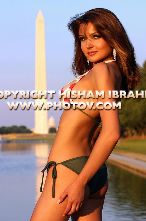 Sexy patrotic woman in bikini by the Washington Monument, Washington DC, USA
