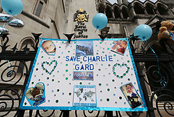 A poster in support of Charlie Gard outside the Royal Courts of Justice in London ahead of the latest High Court hearing in a five-month legal battle over whether the terminally-ill baby should be treated by a specialist in America.