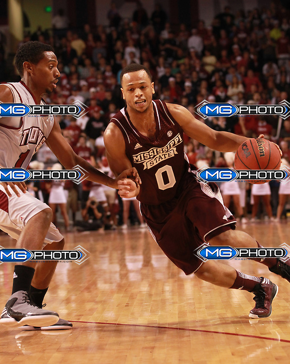 Nov 9, 2012; Troy, AL, USA; MIssissippi State Bulldogs guard Jalen Steele (0) drives to the basket as Troy Trojans guard Emil JOnes (10) defends Trojan Arena. Mandatory Credit: Marvin Gentry-