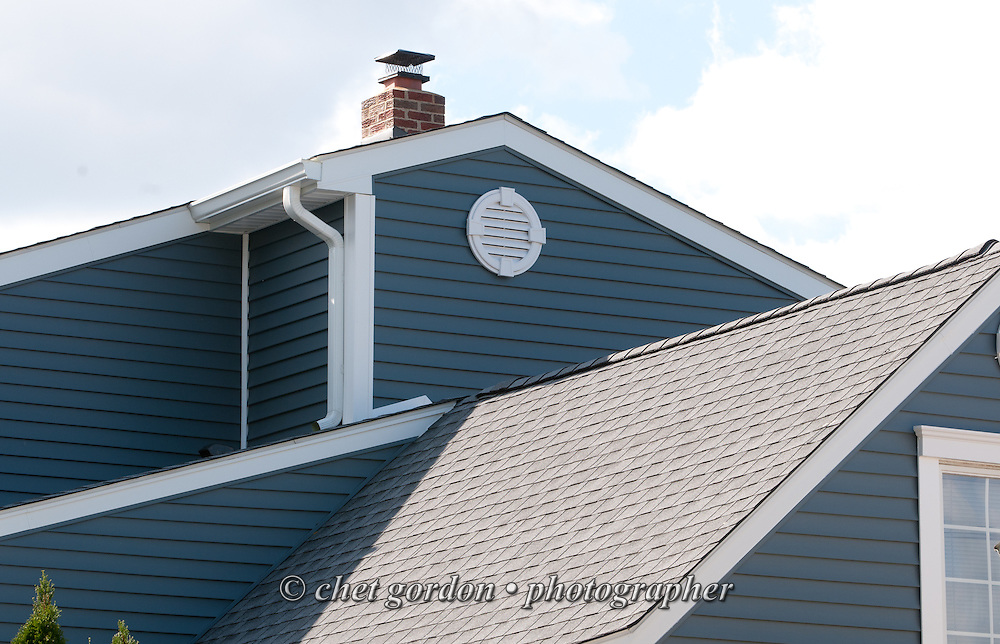 Roof lines seen from the rear of Craig Furer's Cranford, NJ home on Sunday, October 23, 2016. Furer and his wife Jen hired Magnolia Home Remodeling Group to complete a full exterior makeover. The company replaced the siding with shake and clapboard, added various architectural accents, replaced the roof, modified the roofline, built a front portico and replaced two windows. Craig spent a lot of time researching this project before it began and is thrilled with the overall result.  © Chet Gordon for Angie's List