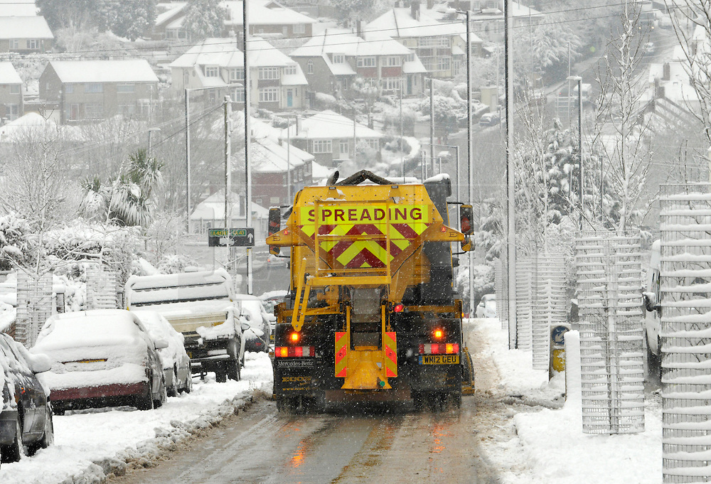 © Licensed to London News Pictures. 18/01/2013. Bristol, UK. Heavy snow disrupts traffic on the A37 Wells Road in Bristol with lorries queueing for hours before being able to descend an icy hill with help from gritters. 18 January 2013..Photo credit : Simon Chapman/LNP