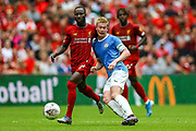 Manchester City midfielder Kevin de Bruyne (17) leans against Liverpool midfielder Naby Keita (8) during the FA Community Shield match between Manchester City and Liverpool at Wembley Stadium, London, England on 4 August 2019.
