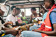 Igamen Gistav (third from left) gets a ride from the Haitian border town of Ouanaminthe to a nearby town to start over again with her husband Josue and their sister's child. They are one of the hundreds of self deportees who have already streamed back into Haiti fearing further violence in the Dominican Republic in the face of the new immigration laws.