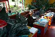 Rinchen Khandro, a Buddhist nun from the Samye Ling community in southern Scotland - where she works in the monastery's administration - sorting mail on her final day at Eskdalemuir before travelling to Holy Island off the west coast where the former model, songwriter and fashion designer will spend the next three years in retreat with 11 other women.
