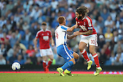 Nottingham Forest midfielder Henri Lansbury (10) battles for possession with Brighton & Hove Albion's central midfielder Steve Sidwell (14) during the EFL Sky Bet Championship match between Brighton and Hove Albion and Nottingham Forest at the American Express Community Stadium, Brighton and Hove, England on 12 August 2016.