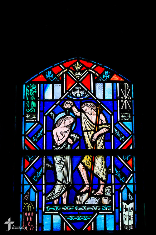 Stained glass at Luther Memorial Chapel depicts the baptism of Jesus by John in the Jordan, Mark 1:9, on Friday, Jan. 29, 2016, in Shorewood, Wis. LCMS Communications/Erik M. Lunsford