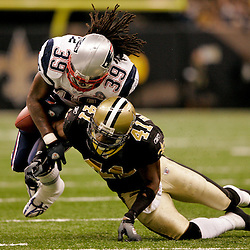 2009 November 30: New Orleans Saints safety Roman Harper (41) hits New England Patriots running back Laurence Maroney (39) during the the first half at the Louisiana Superdome in New Orleans, Louisiana.