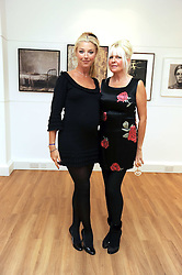 Left to right, TAMARA BECKWITH and LINDSEY CARLOS CLARKE at a private view of 'Most Wanted' an exhibition of photographs held at The Little Black Gallery, Park Walk, London on 27th November 2008.