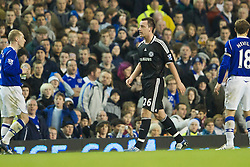 LIVERPOOL, ENGLAND - Monday, December 22, 2008: Chelsea's captain John Terry leaves the pitch dejected after being sent off by referee Phil Dowd during the Premiership match against Everton at Goodison Park. (Photo by David Rawcliffe/Propaganda)