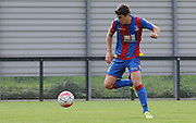 Jake Gray controls the loose ball during the U21 Professional Development League match between Crystal Palace U21s and Huddersfield U21s at Imperial Fields, Tooting, United Kingdom on 7 September 2015. Photo by Michael Hulf.