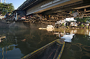 PHILIPPINES - A River Runs Foul: Over a quarter million people are in trouble of losing fresh water should the pollution embedded in the sediment and daily surface garbage thrown in by locals reach their groundwater tablet running through municipalities just north of Manila, Philippines. Photo by Johnny Bivera