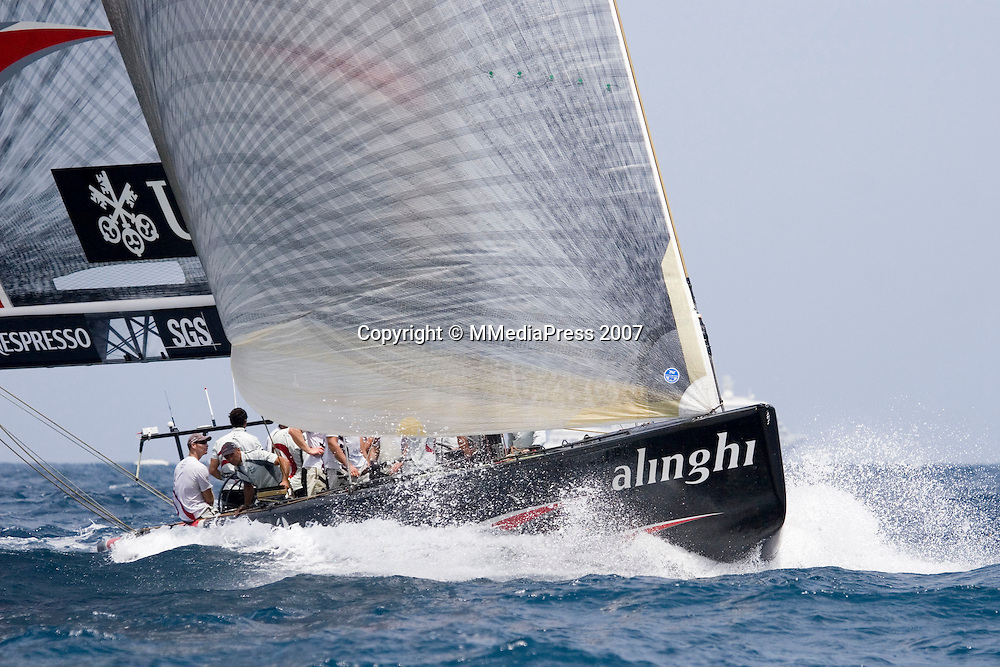 Alinghi SUI100 races against Emirates Team New Zealand NZL92 during the first race of the 32nd America`s Cup in Valencia, Spain on Saturday 23 June 2007. Alinghi won the match by 33 seconds. Photo : Ignacio Baixauli/PHOTOSPORT