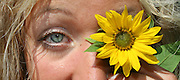 attractive woman with sunflower eye