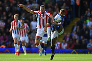 Stoke City forward Lee Gregory (19) battles for possession  with Birmingham City midfielder David Davis (26) during the EFL Sky Bet Championship match between Birmingham City and Stoke City at the Trillion Trophy Stadium, Birmingham, England on 31 August 2019.