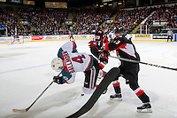 KELOWNA, CANADA - MARCH 1: Nikita Popugaev #29 and Jesse Gabrielle #13 of the Prince George Cougars check Gordie Ballhorn #4 of the Kelowna Rockets during first period on MARCH 1, 2017 at Prospera Place in Kelowna, British Columbia, Canada.  (Photo by Marissa Baecker/Shoot the Breeze)  *** Local Caption ***