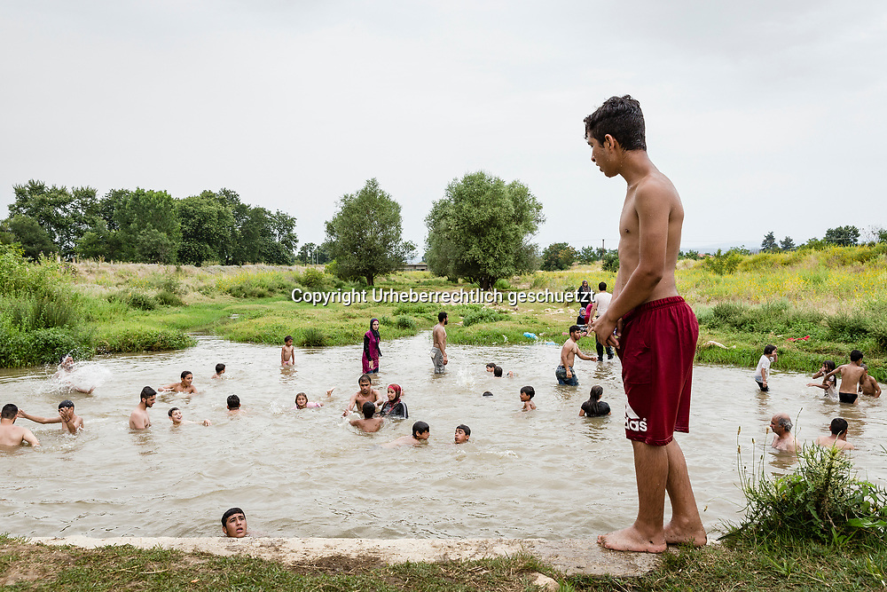 Greece, Lagkadikia, nearby the refugee camp is a little pond, which belongs to a river which dries out. The refugees take their chance to have some fun and refresh in this little pond.