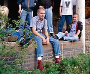 New Skins sat on wall. UK, 1980s.