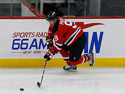 Jan 4, 2008; Newark, NJ, USA; New Jersey Devils left wing Zach Parise (9) skates with the puck during the third period at the Prudential Center. The Devils defeated the Senators 4-3 in overtime.