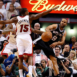 Jun 9, 2013; Miami, FL, USA;  San Antonio Spurs point guard Tony Parker (9) passes against Miami Heat point guard Mario Chalmers (15) during the first quarter of game two of the 2013 NBA Finals at the American Airlines Arena. Mandatory Credit: Derick E. Hingle-USA TODAY Sports