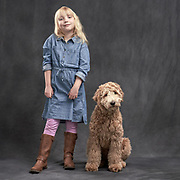 Girl and her doodle standing in the studio