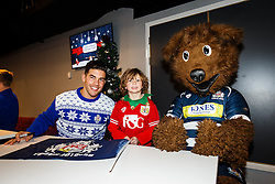 Ben Mosses and Brizzley of Bristol Rugby pose with a young fan as Season ticket holders and members of Bristol Sport 7s and Forever Bristol take part in a Bristol Sport Christmas Party - Mandatory byline: Rogan Thomson/JMP - 22/12/2015 - SPORT - Ashton Gate Stadium - Bristol, England - Bristol Sport Christmas at Ashton Gate.