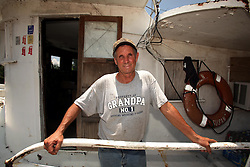 10 June 2010. Breton Sound Marina, Hopedale, Louisiana. USA.  <br /> Paul Trosclair, a fisherman all his life on his boat the Karen Susan. Trosclair is now subcontracted to BP. A religious man, Trosclair wonders if he is not seeing the 'end of days,' as predicted in Revelations where he believes the Bible reads one of the signs will be 'when the sea turns to blood.' He does not know when or if he will ever be able to return to shrimping. He puts his faith in the Lord.<br /> The ecological and economic impact of BP's oil spill is devastating to the region. Oil from the Deepwater Horizon catastrophe is evading booms laid out to stop it thanks in part to the dispersants which means the oil travels at every depth of the Gulf and washes ashore wherever the current carries it. The Louisiana wetlands produce over 30% of America's seafood and oil and gas production. They are the most fertile wetlands and nurseries of their kind in the world. BP's oil is killing everything.<br /> Photo; Charlie Varley/varleypix.com