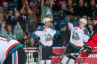 KELOWNA, CANADA - FEBRUARY 18: Devante Stephens #21 and Braydyn Chizen #22 of the Kelowna Rockets celebrate a second period goal against the Prince George Cougars on February 18, 2017 at Prospera Place in Kelowna, British Columbia, Canada.  (Photo by Marissa Baecker/Shoot the Breeze)  *** Local Caption ***