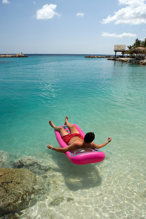 Man on pink raft, Curacao, Netherlands Antilles